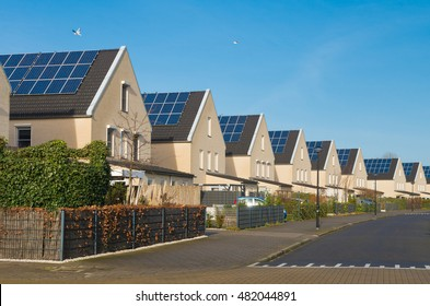 row of newly build modern houses with solar panels in the netherlands