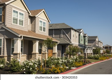 A row of newly-built houses in a residential subdivision.