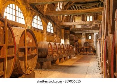Row of oak barrels in Calvados distillery, Normandy, France