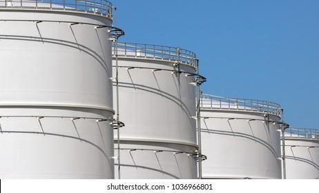 Row of oil storage tanks.