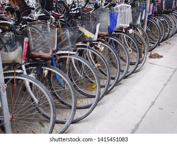 Row of Old Bicycles Parking on Street