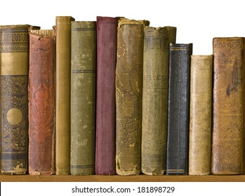 Row of old books on a bookshelf. Many of the books show lots of wear and damage from aging.