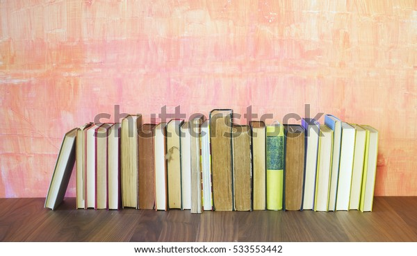 row of old books on grungy background, good copy space
