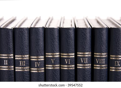Row of old books with roman numbers