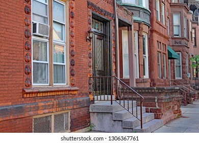 row of old brownstone type townhouses