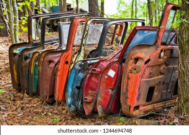 A Row of Old Doors off Scrap Vehicles in a Junk Yard