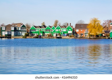 Row of old dutch green traditional houses in town Zaanse Schans in Netherlands, North Holland near Amsterdam, copy space, place for text