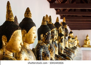 Row of old golden buddha statue at Wat Phra Boromathat Chaiya, Surat Thani province, south of Thailand