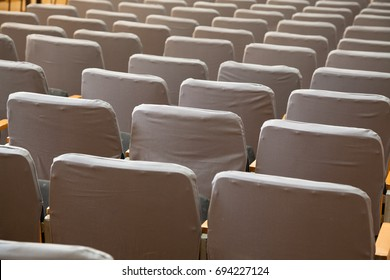 row of old grey seats in cinema