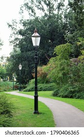 Row of old lantern posts in a park in the Netherlands. Park in Amersfoort