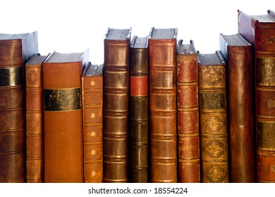 A row of old leather bound books isolated on a white background