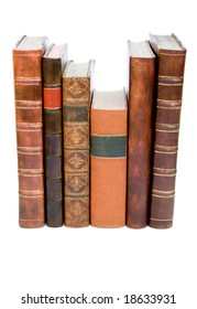 Row of old leather bound books isolated on a white background
