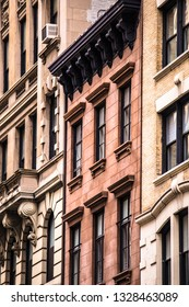 Row of old New York City apartment building facades including brownstones