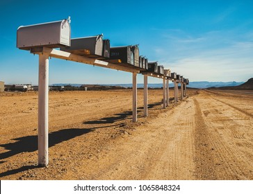 Row of old and weathered mailboxes in desert, in the middle of nowhere on a sunny day, Arizona, United States of American- Postal and delivery concept