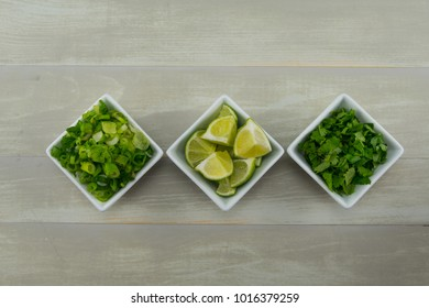 Row of Onion Lime and Cilantro in White Bowls
