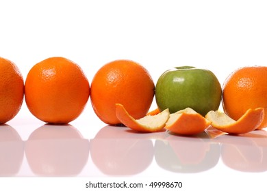 Row of oranges and an apple showing its true nature