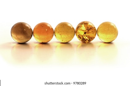 Row of Ordered Golden Glass Marbles