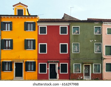 A row of painted houses in Burano Venice