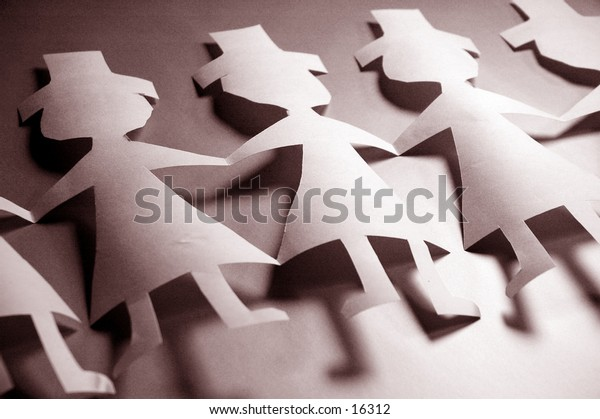 A row of paper dolls in black and white