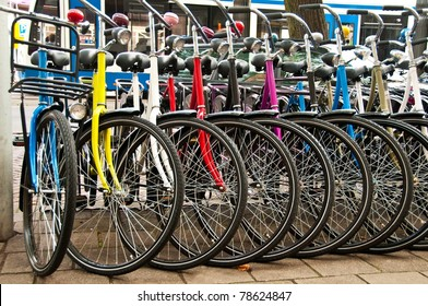 Row of parked colorful bicycles