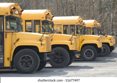 Row of parked yellow school buses