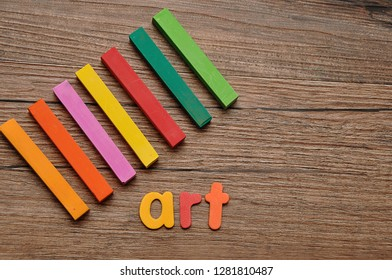 A row of pastels with the word art