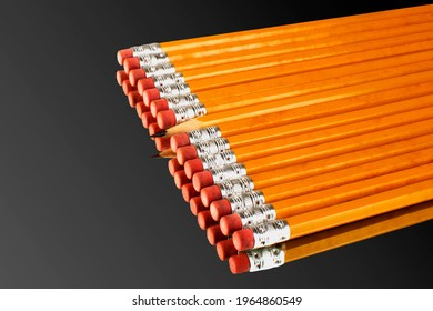 A row of pencils with one exception of a sharp one turning its head against the direction of the rest. This photo is metaphorical in the sense it signifies the oddities of being unique inour society.