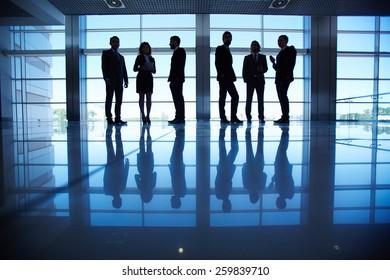 Row of people in formalwear in the dark