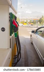 row of petrol station pupmps and car close up