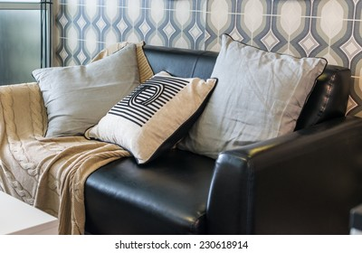 row of pillows on sofa in living room