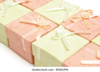 A row of pink and green jewelry boxes.