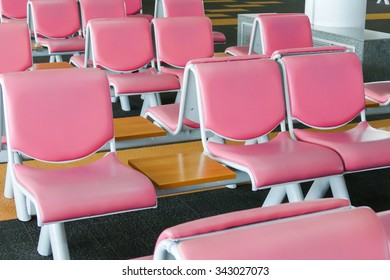 row of pink leather chair for passenger at the gate in the airport