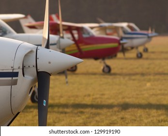 Row of planes' propellers at autumn sunset