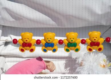Row of plasic teddys in baby's pushchair