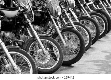 A row of police motorcycles at a protest rally