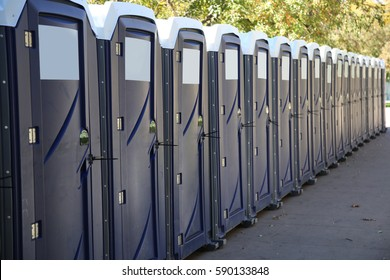 Row of portable toilets on a city street