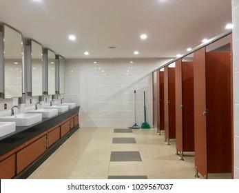 Row of public toilet, wooden door in public restroom