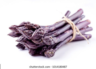 Row purple Asparagus as close-up with copy space â?? covered
