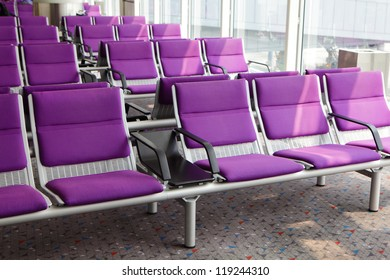row of purple chair at airport, shot in asia, china,