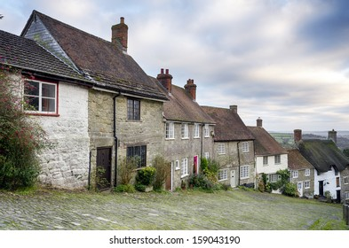 Row of quaint English cottages at Gold Hill in Shaftesbury in Dorset.