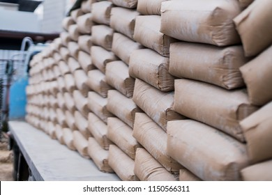 row of raw cement bag stack on truck site construction ideas concept