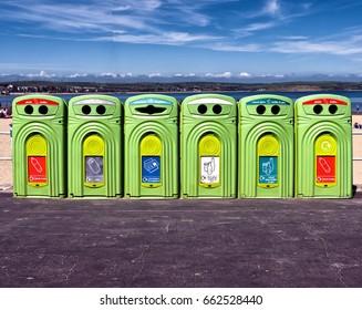 Row of recycling bins