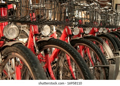 Row of red bicycles for hire in Bolzano, Italy