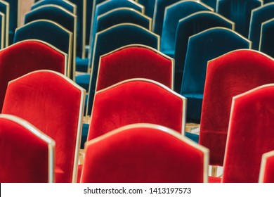 Row of red and blue chairs with golden edge at an important seminar in conference hall for guest and attendee to sit