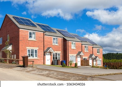 Row of red brick english houses with solar panels