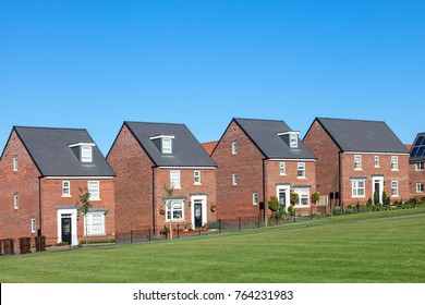 Row of red brick english houses