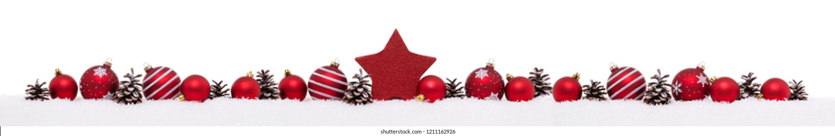 Row of red christmas balls with xmas present gift boxes isolated on snow