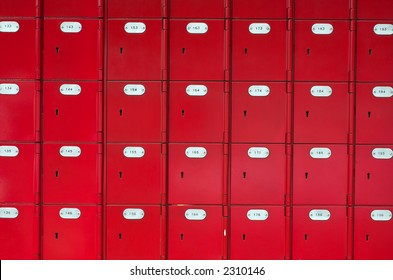 Row of red post office boxes