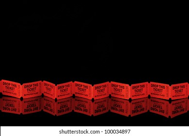 Row of red tickets on a black reflective surface