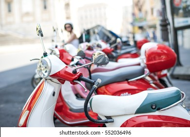 Row Red Vespas (focus on the first Vespa)